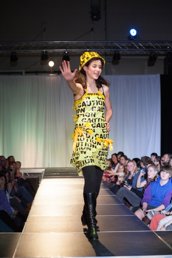 Be-wear of Fashion Designer: Emma Pyott Materials: Used Caution tape, string
