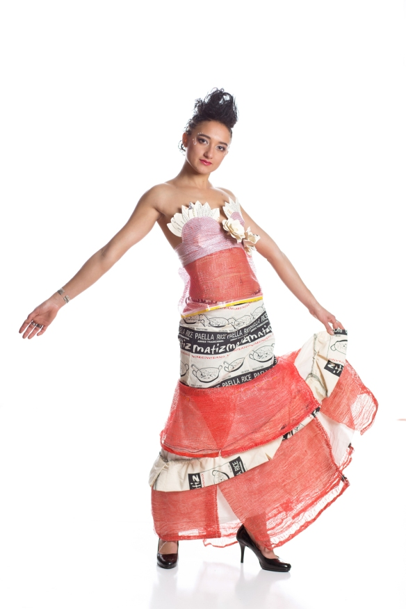 Barrio Paella Princess Designer: Alisha Simonson Model: Paris Durham Materials: paella rice & onion bags, old menus, cans, wine bottles and other material from the bar! Materials: